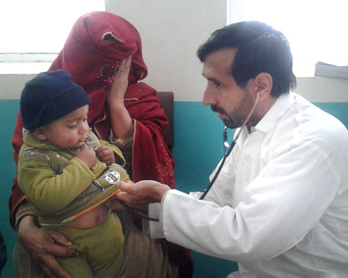 Doctor treating Afghan child