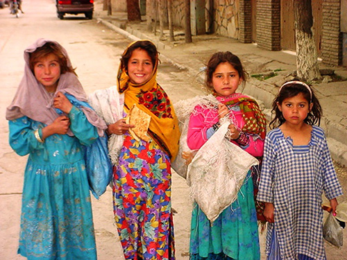 Four Afghan girls smiling