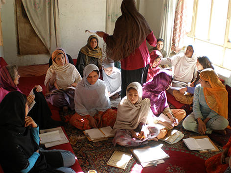 Afghan women learning to read in literacy class