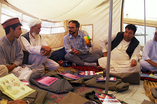 Afghan men being trained in Birth Life Saving Skills in Internally Displaced People Camp