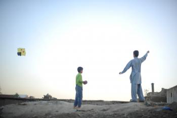 Afghan boys flying kite