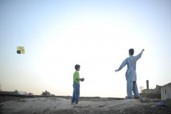 Afghan boys flying kite