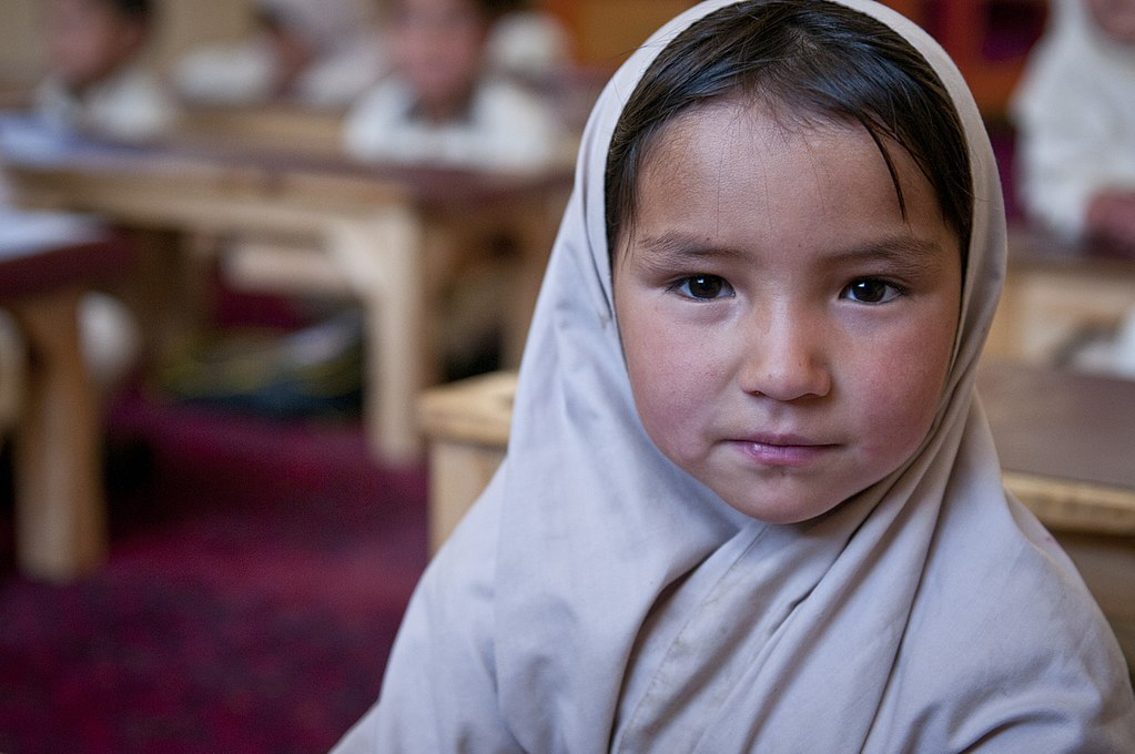 Afghan girl listening to lesson in classroom